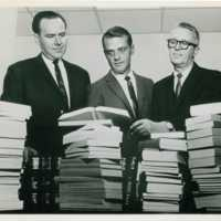 Carl H. Elliot and Charles H. Hutton accepting library book donation from American Society for Testing and Materials<br /><br />